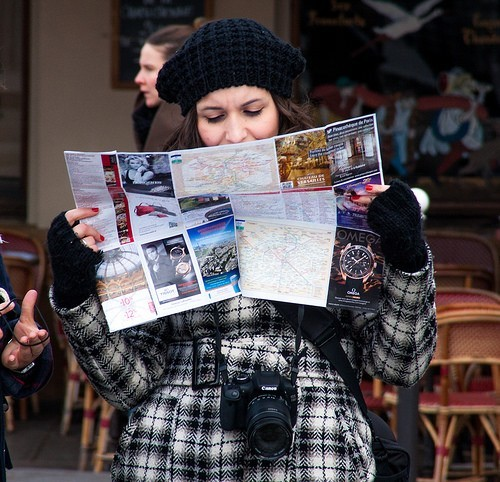 Lost tourist looking at map.