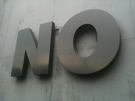 Big sign reading 'NO'.