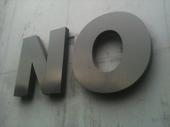 Big sign reading 'NO'.