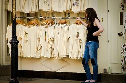 Woman selling t-shirts.