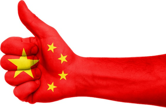 Thumbs up with China flag superimposed.