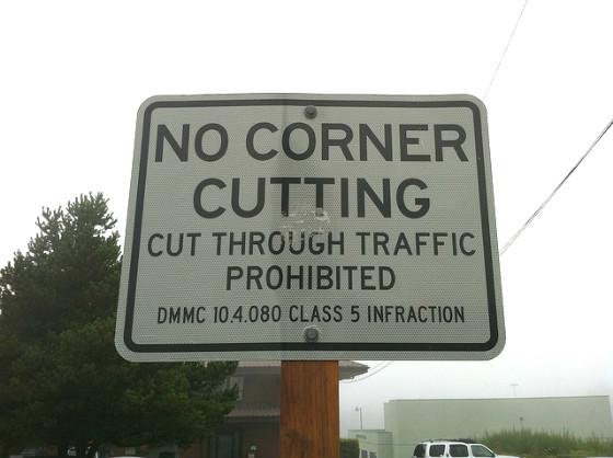 "Sign reading: ""No Corner Cutting""."