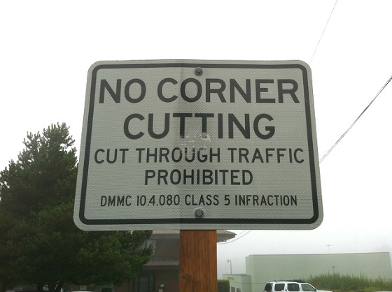 "Sign reading: ""No Corner Cutting""."