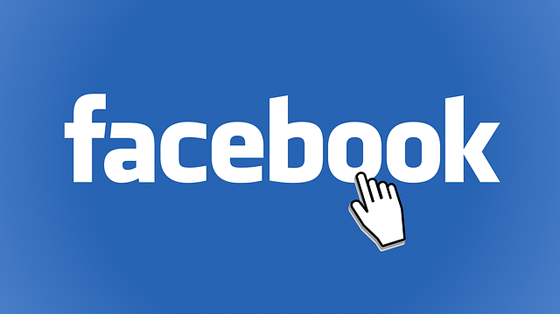 Facebook logo with mouse pointer.