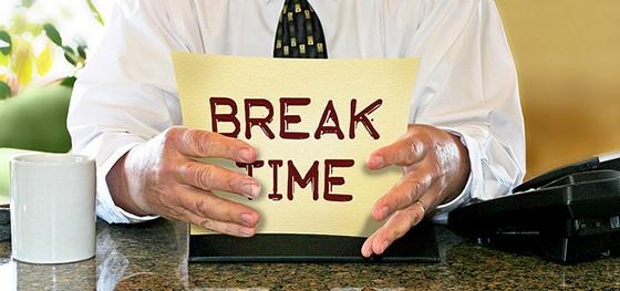 Man holding sign reading 'Break Time'.
