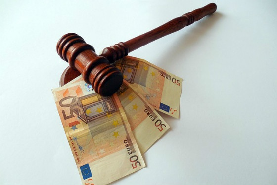 Judge's gavel with euro notes.