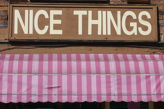 A shop sign that reads 'Nice Things'.