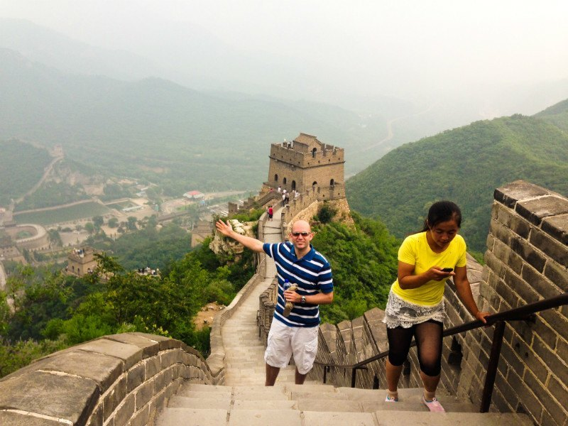 Phil walking on the Great Wall of China.