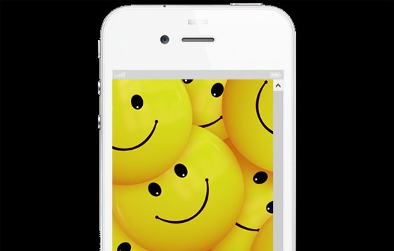 iPhone with smiley faces on display.