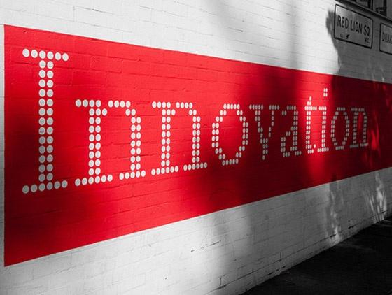 Wall art reading 'Innovation'.
