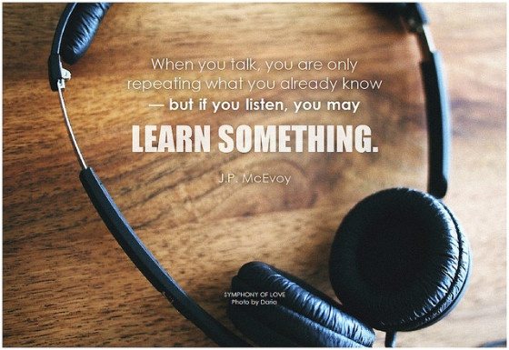 "Picture of headphones with the J P McEvoy quote ""When you talk, you are only repeating what you already know - but when you listen, you may learn something."""