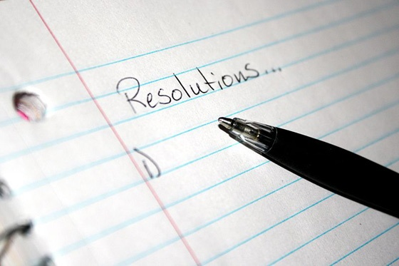 'Resolutions' written at the top of a notepad.