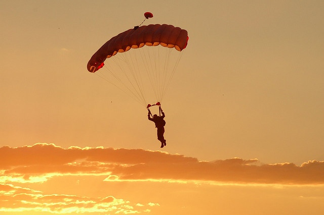 Skydiving at sunset.