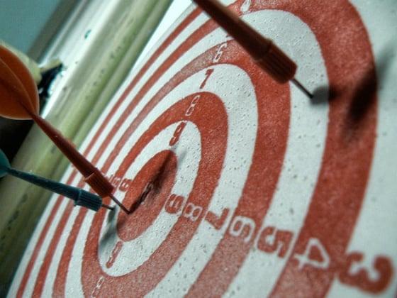 Dartboard with darts.