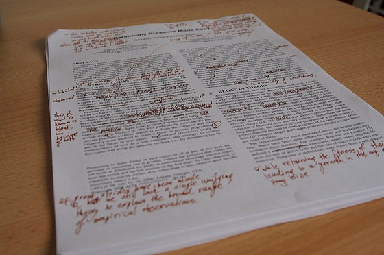 A page of text with proofreading marks.