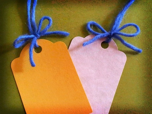 Two 'tags' made with card and wool