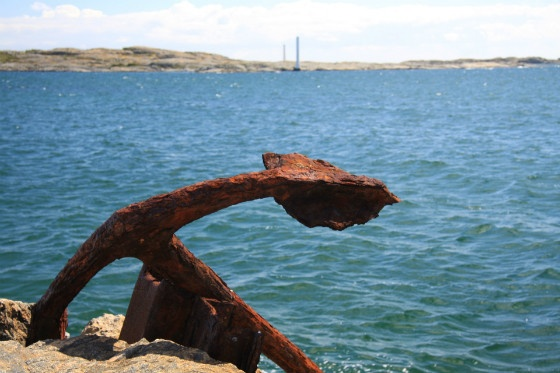 rusty anchor and sea