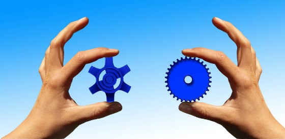 Hands and cogs