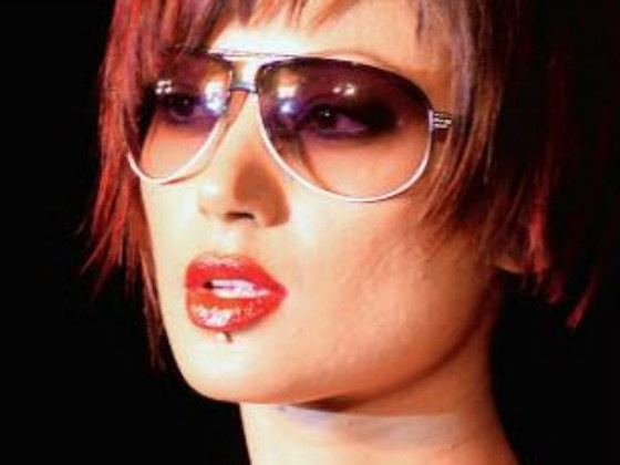 model wearing ray ban sunglasses