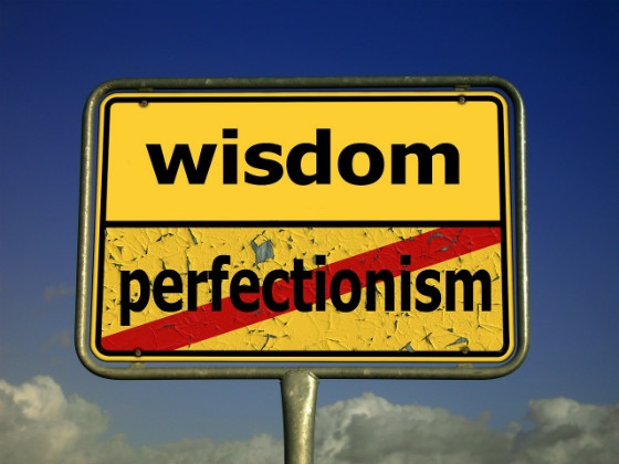 Wisdom / Perfection road sign